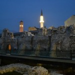 The lunar clock tower and central Mosque by twilight. Old castle walls dominate the foreground.
