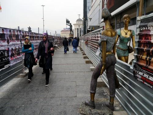 Strange sculptures chat over building site boardings
