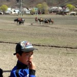 A Kyrgyz youngster looks on