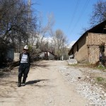 A Kyrgyz man carries a heavy load home