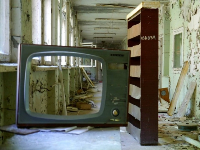 A TV and bookcase in Pripyat High School