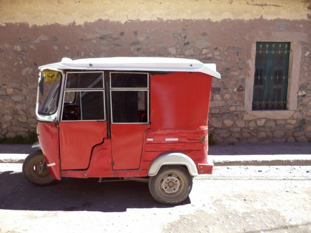 A red tuk tuk in Colombia