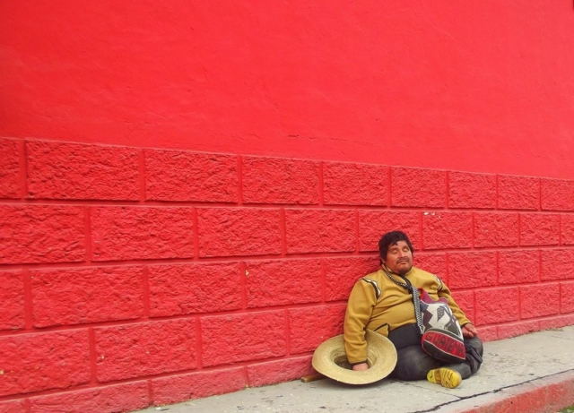 A Guatemalan man takes a well earned snooze on the street