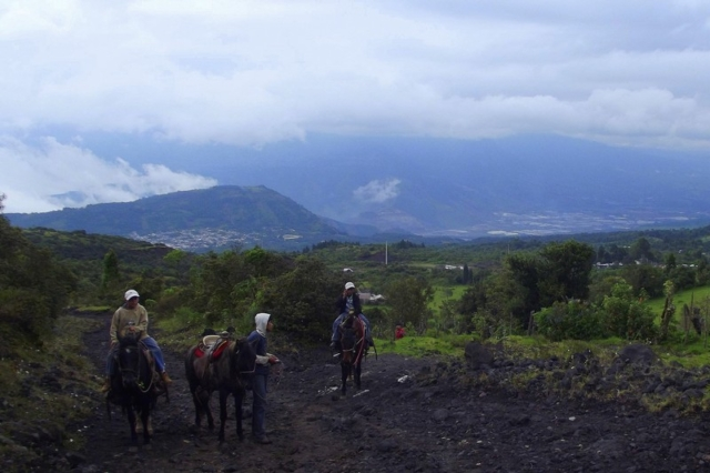 Young entrepreneurs offer rides up an active volcano in Guatemala