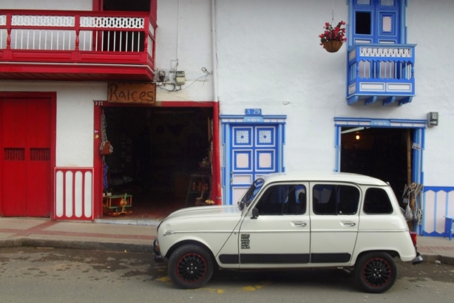An old classic outside colourful houses in Salento, Colombia