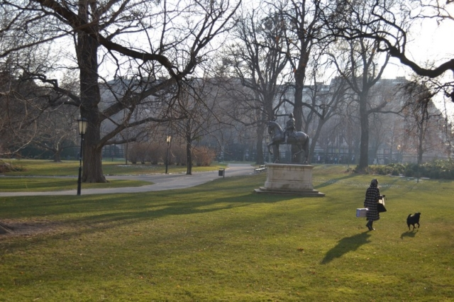 A woman and a dog in a park in Venice