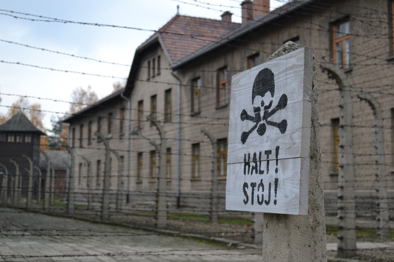 Barbed wire and warning sign in Auschwitz