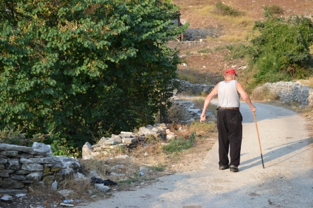 An old Albanian man with a walking stick