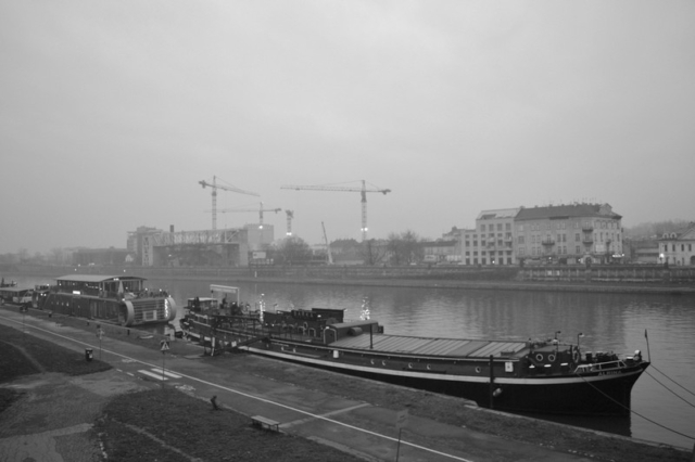 Boats on the Vistula river with the old ghetto in the distance, Krakow