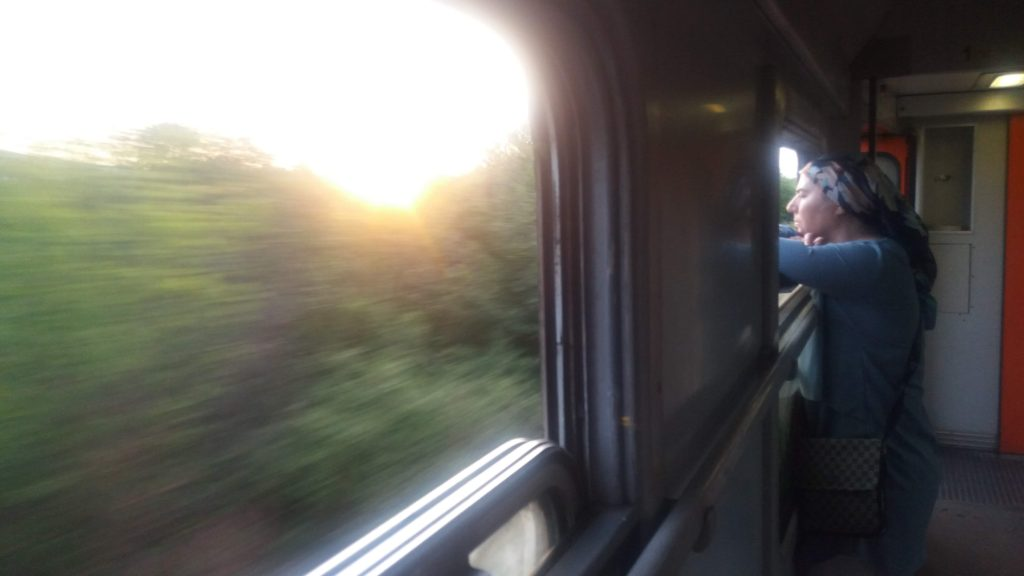 A woman leans out a train window - Belgrade to Sofia