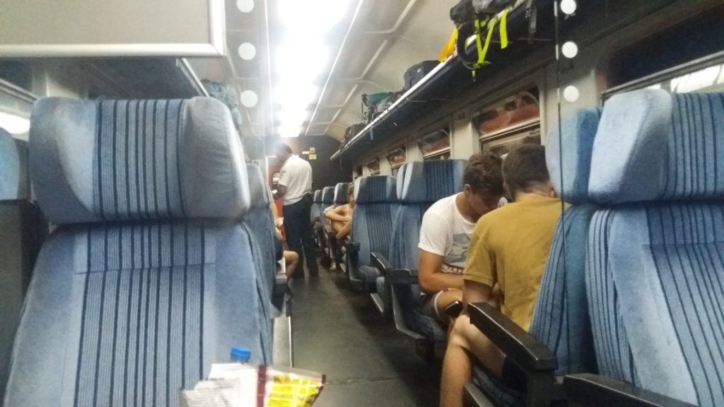 People on a train at night